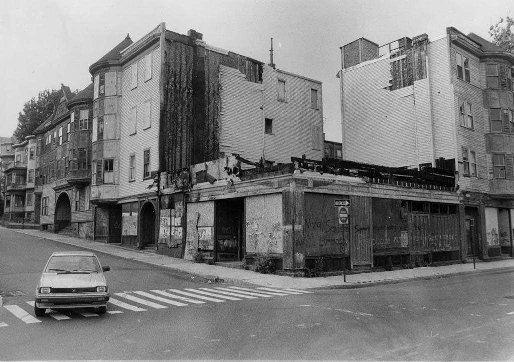 This row of buildings at Paul Gore and Lamartine Streets was known as Jacob's Block. The corner building was a pharmacy with a soda stand. The pharmacists were Mr. Wholley and Charlie Tuite. A bar stood on the corner across from the pharmacy and featured entertainers on Saturday nights. This property later became the center of a battle waged between the landlord George Carroll and a group of residents supported by community activists and organizations. Photograph taken by and provided courtesy of Mark Hoffman.