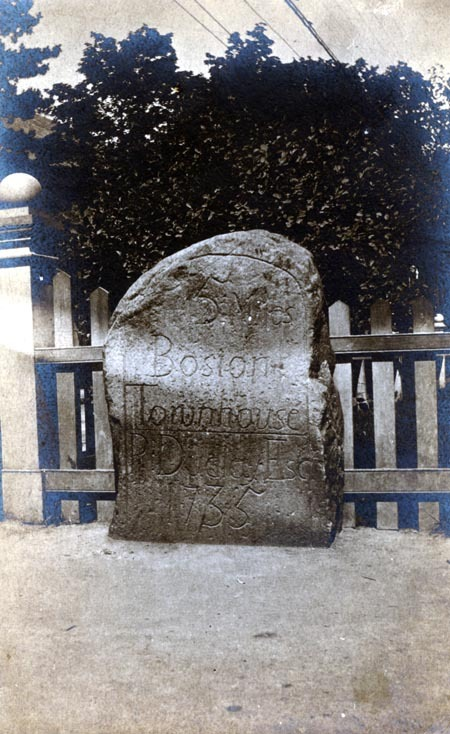 One of five mile markers that remain in the early Roxbury town limits (including West Roxbury and Jamaica Plain until 1851), untouched for the most part by politics, urban redevelopment, and other forms of change and still performing their original function. These milestones show the distance to the Boston Town House (now the Old State House). Pictured here is the five mile marker installed in 1735 and located by the monument at Centre and South Streets in Jamaica Plain. While this marker currently stands closer to the monument, it is shown here as previously located on the opposite side of street from the monument.