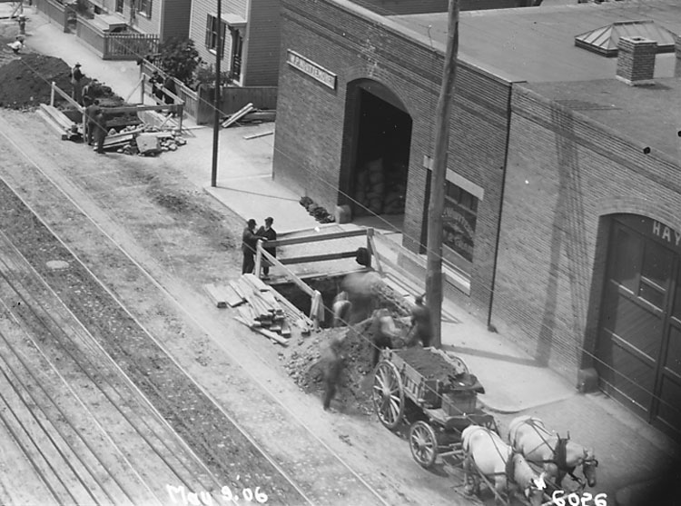 Looking southwest in 1906 down Washington Street from Green Street. Excavations are under way for the construction of the elevated railway (the old Orange line) that will run down Washington Street. This is an enlargement of a portion of another image that also appears in this collection. The elevated tracks were torn down in 1987 and replaced with the new Orange Line subway. Photograph courtesy of David Rooney.