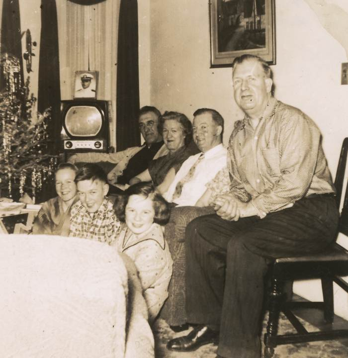 Christmas at the Cradocks, 1950. Seated are Dad, Uncle Jack Dooley, Mom, Uncle Pat Tighe. On the floor are Cousin Noreen Dooley, Jim and Jack Cradock.
