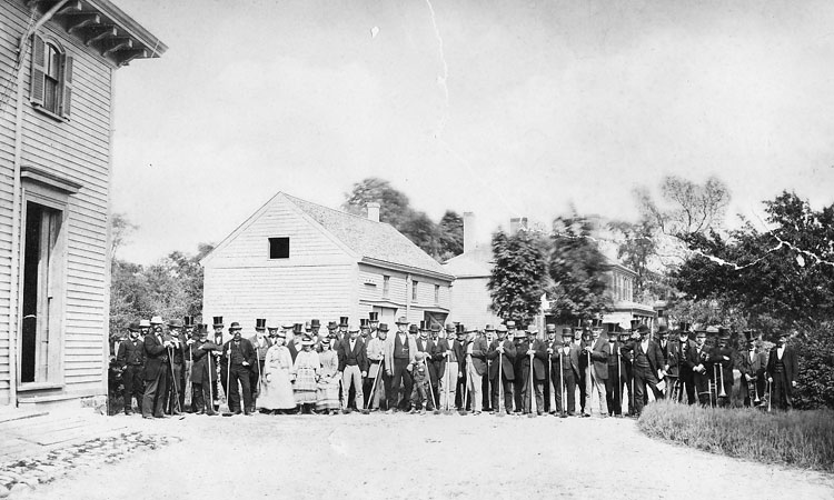 Guests at a hoeing party pose at the Curtis farm on June 4, 1873. A small brass band can be seen at the right. Photograph courtesy of Martha Tyer Curtis and the late Nelson Curtis Jr.