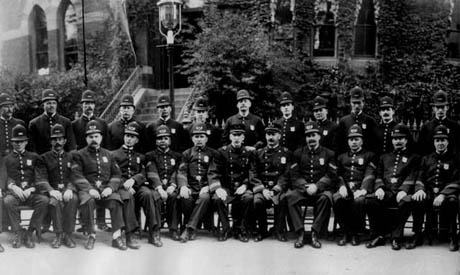 Police officers pose in front of the former District 13 Police Station at 28 Seaverns Ave.