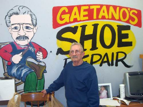 Guy Perito stands in front of a sign in his shop at Building #19