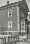 Ed looks out the window of 257 Lamartine St. in 1931