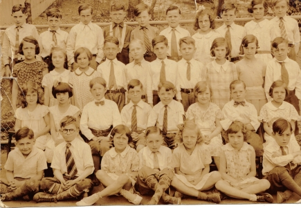 Photogaph of Dorothy Neagle Cook's fourth grade class at the Margaret Fuller School. Dorothy is seen front row, second from the right, wearing a ribbon in her hair. A larger view of this photograph can be seen at: http://tinyurl.com/000mf