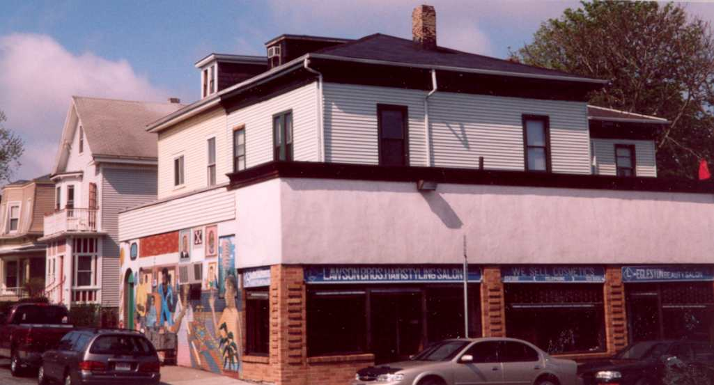 The duplex was similar to the one built behind it in 1872 facing Washington Street that was replaced by a commercial building in 1924.
