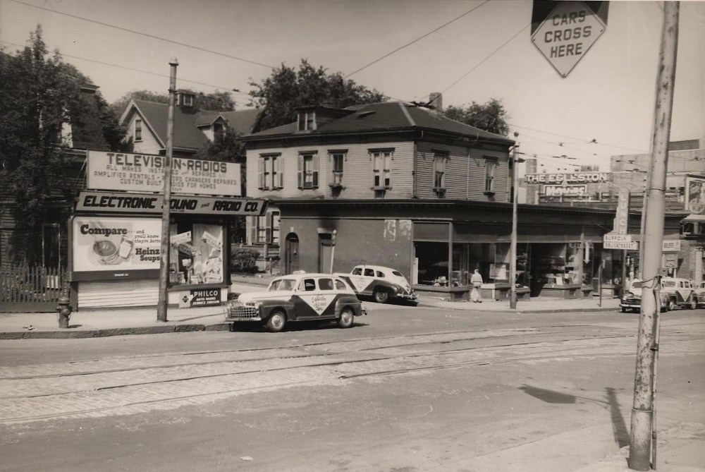 Columbus Avenue at Weld Avenue. 1948. The storefronts were built in 1917. The Radio & TV storefront was built in 1913 around a two family ca 1870 - house at 2 Weld Avenue. This burned in the early 1970's and new stores built in 2008.City of Boston Archives.