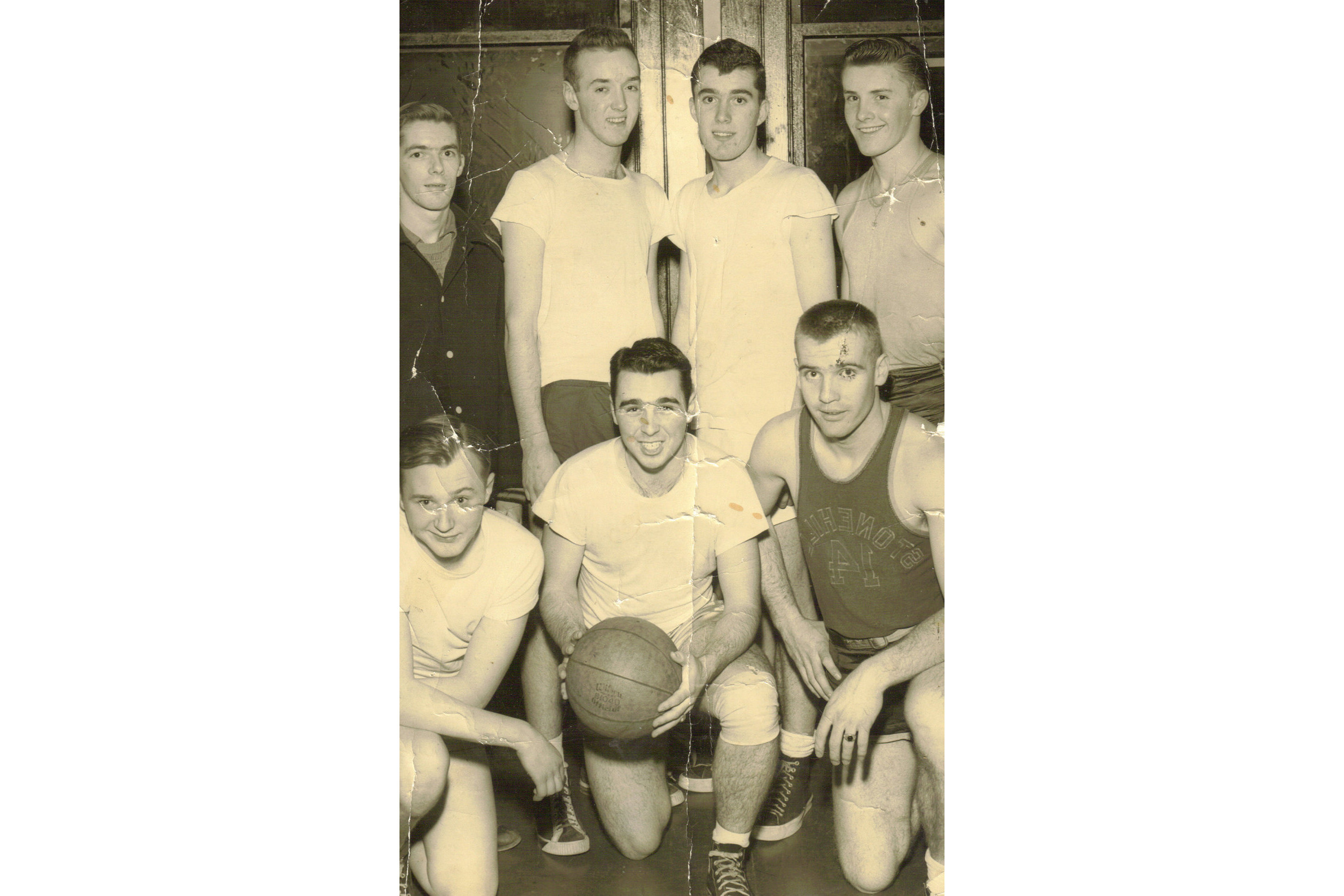 Division Basketball Champs, Park League, 1950. Front row from left to right, Bob Power, Tom Griffin, and Eddie Donovan. Rear row from left to right, Bob Quinn, Dickie Sullivan, Frannie Tighe, and Billy Donovan.