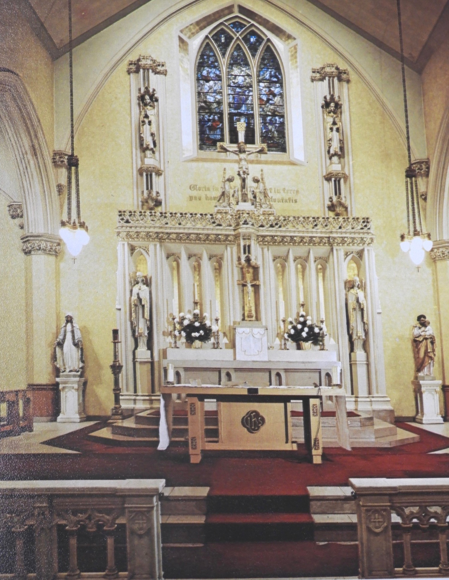 Reredos, altar, rail, and St. Thomas Aquinas window in 1969. From  Centennial of St. Thomas Aquinas Church , 1969. Archives of the Archdiocese of Boston.