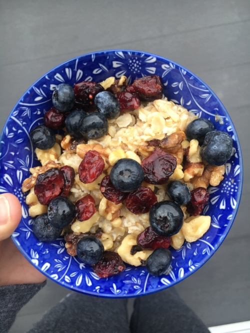 Oatmeal with walnuts, cranberries, fresh blueberries and agave syrup.