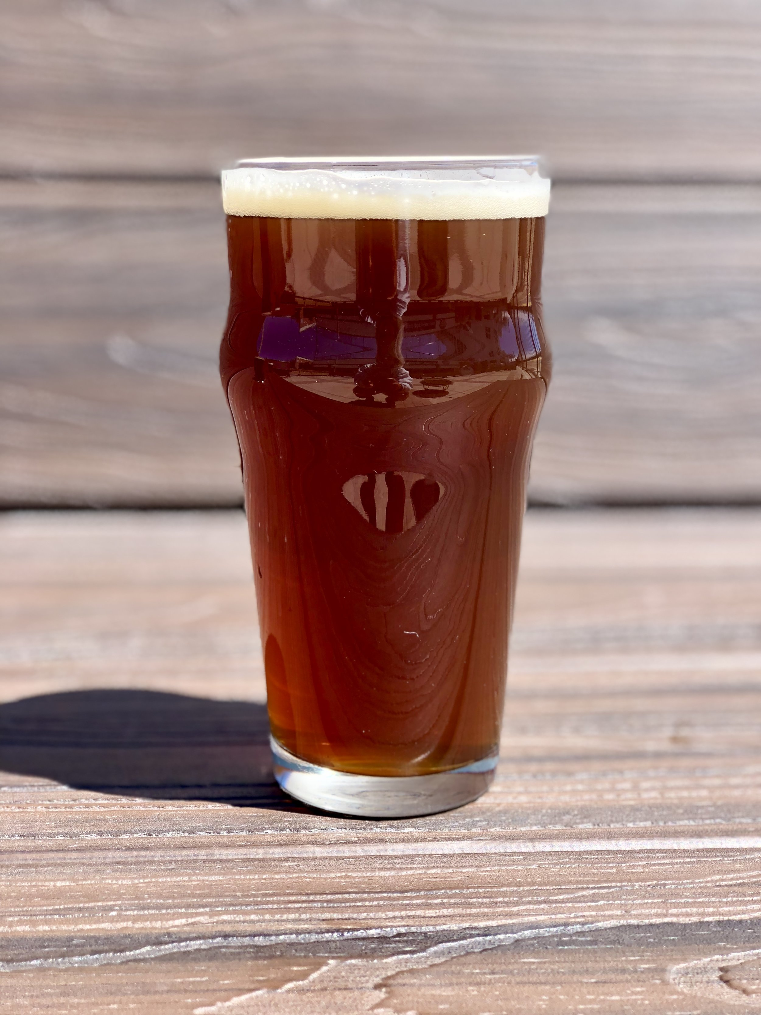 ROUND LAKE RED: 5.1% AVB - 27 IBU   Our version of an Irish Red Ale with an American Twist. Roasted, caramel flavors with not a huge body that keeps her balanced like they are supposed to be.