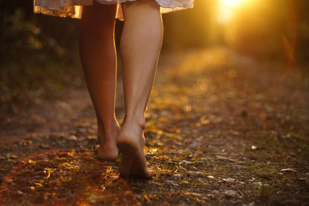 woman-walking-down-path-shutterstock_92746561.jpg
