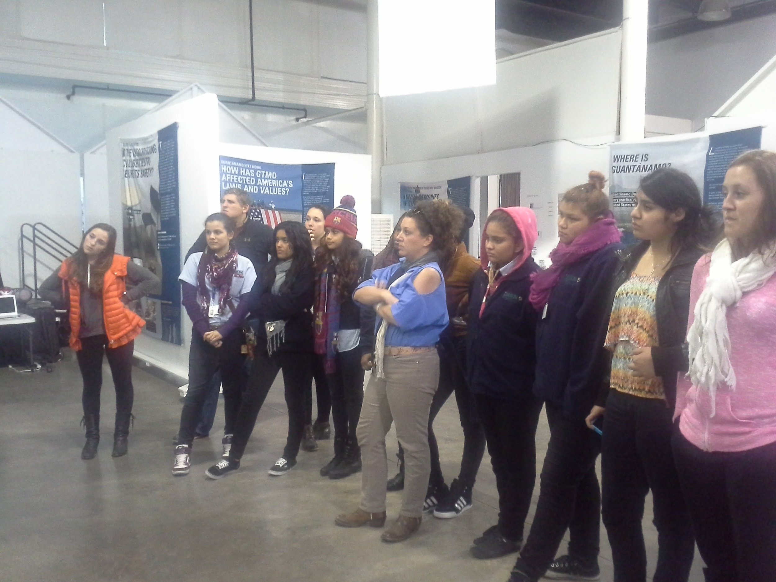 Tulane students, International High School students, and ESL instructor Heather Causey visiting the Guantanamo Public Memory Project at the Ashe Cultural Center in 2015.