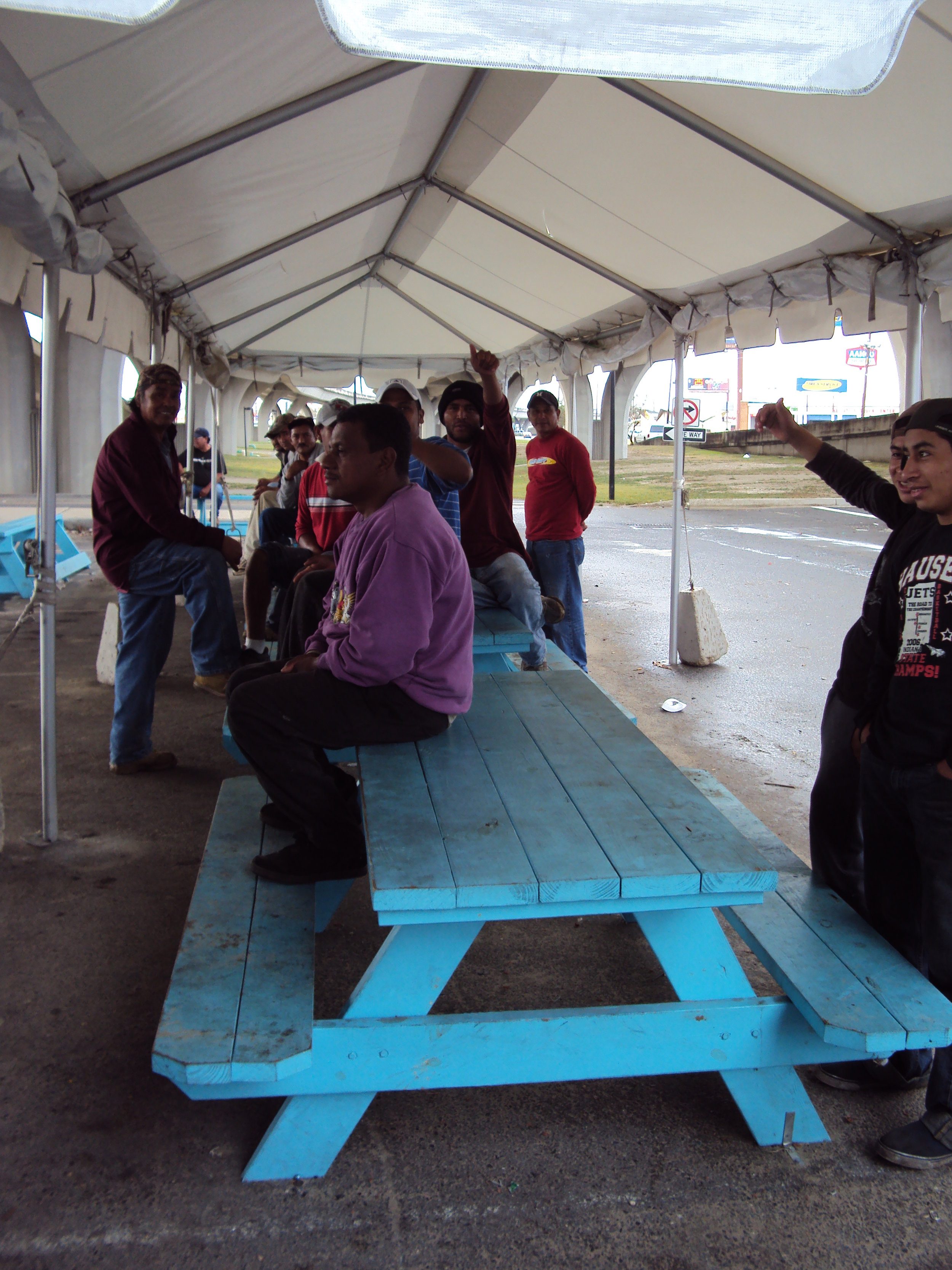 Day laborers at the Gretna corner where the workers partnered with the city to create their own space to look for jobs.