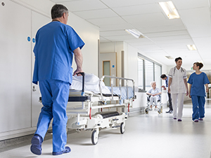 Doctors walking in the halls of a hospital or other health care facility.