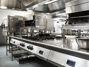 Clean commercial kitchen equipment in a government institution's corporate office.