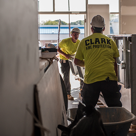 Clark Fire Protection technicians installing a fire suppression system.