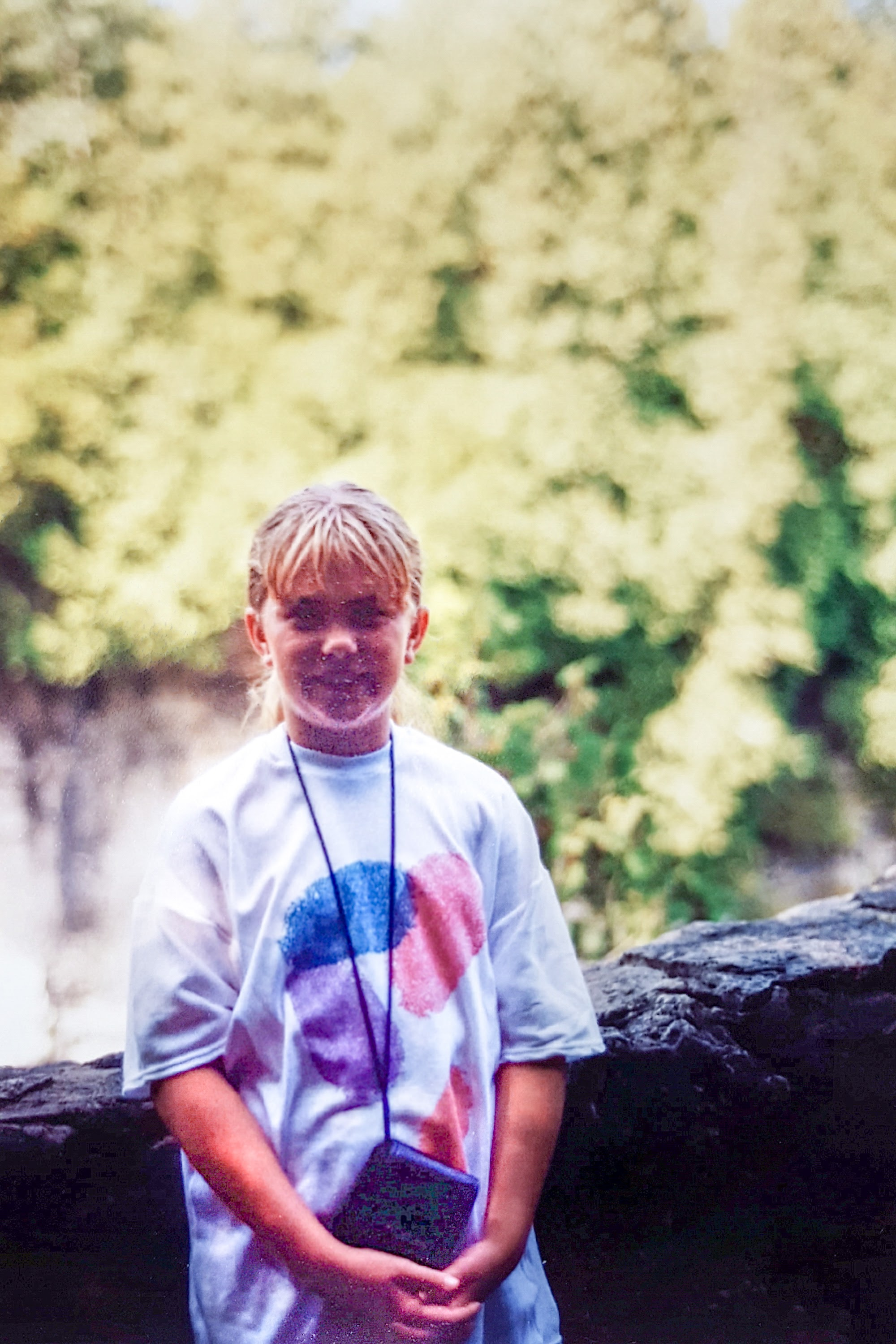 "Me, 9 years old, with my camera and my fingerprint t-shirt, which I truly believed was ""totally rad"". Photo credit: Mom."
