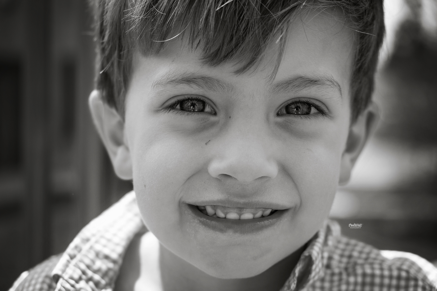 Little boy looking right into the camera smiling close up black and white Family photography Kitchener-Waterloo