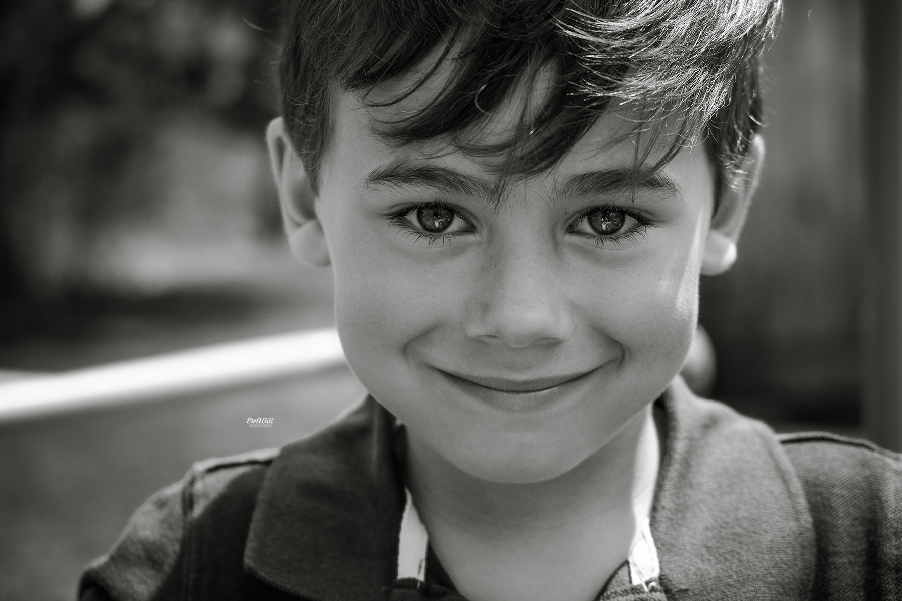 Little boy looking directly into the camera smiling close up black and white Family photography Kitchener-Waterloo