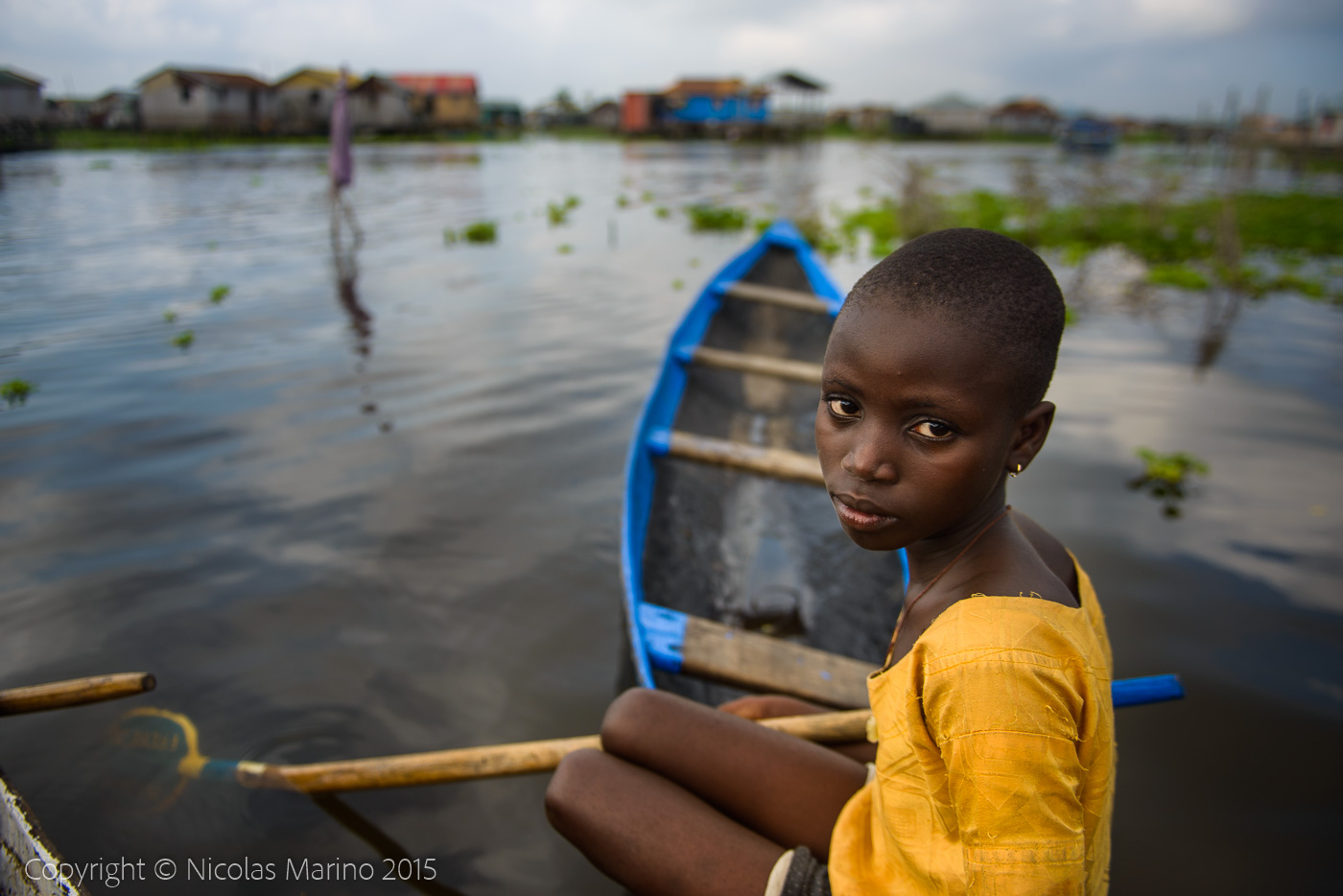 People of the floating village of Ganvié. Benin