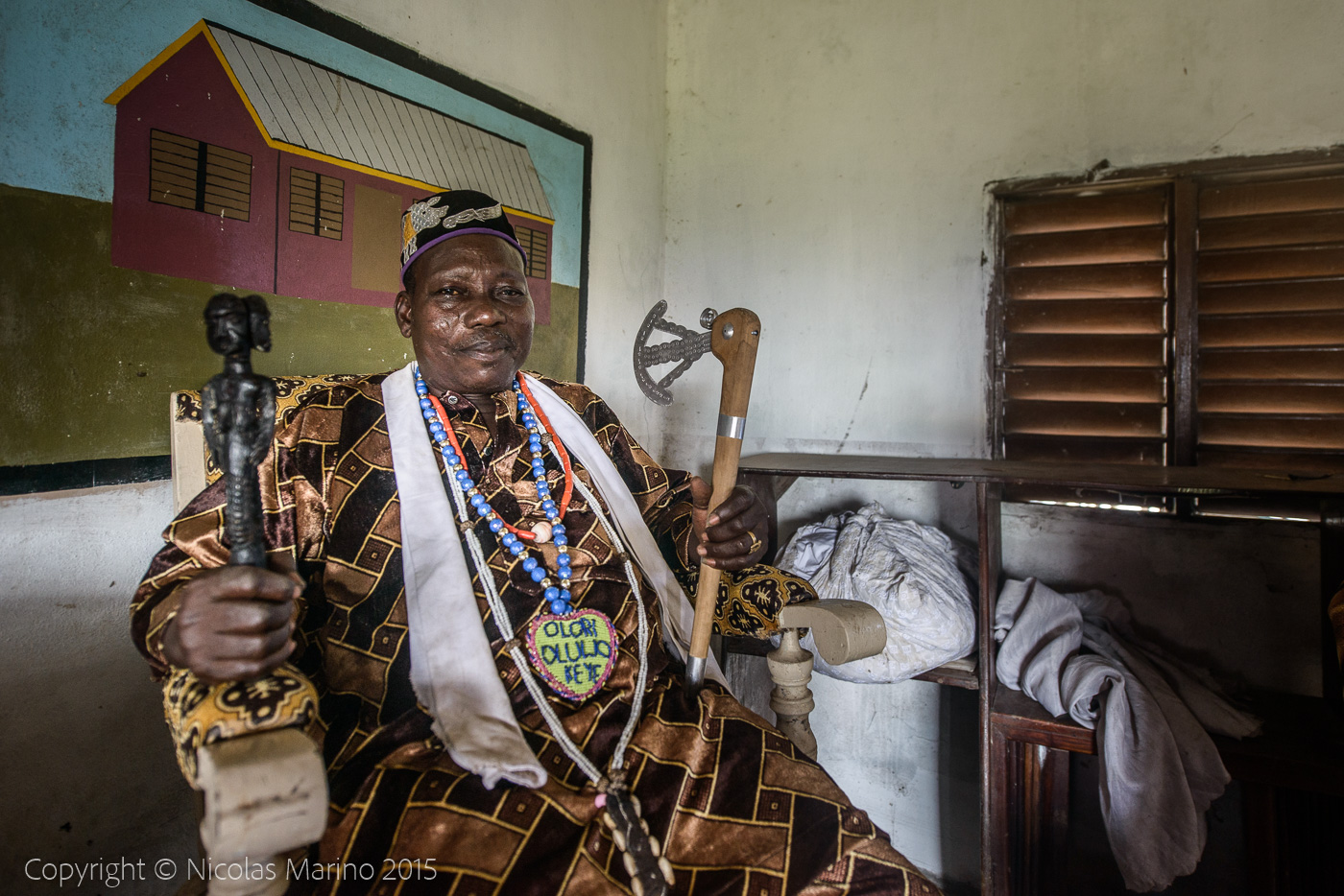 The king of Ganvié, a voodoo priest and his fetishes.