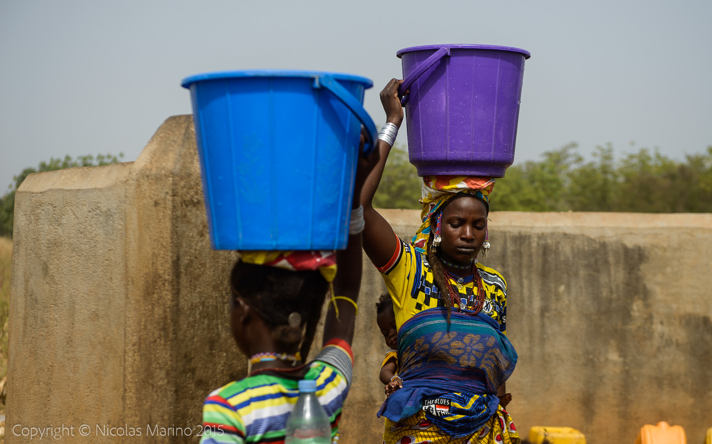 Fulani women getting water at the water pump. Northern Togo