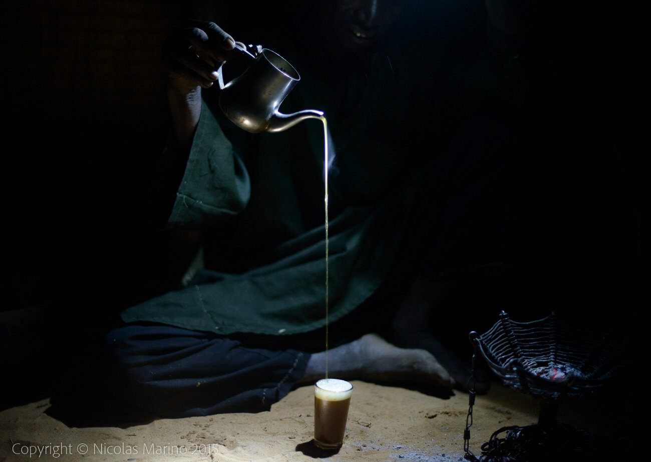 A Fulani man preparing tea, in a village of the Sahel. Burkina Faso