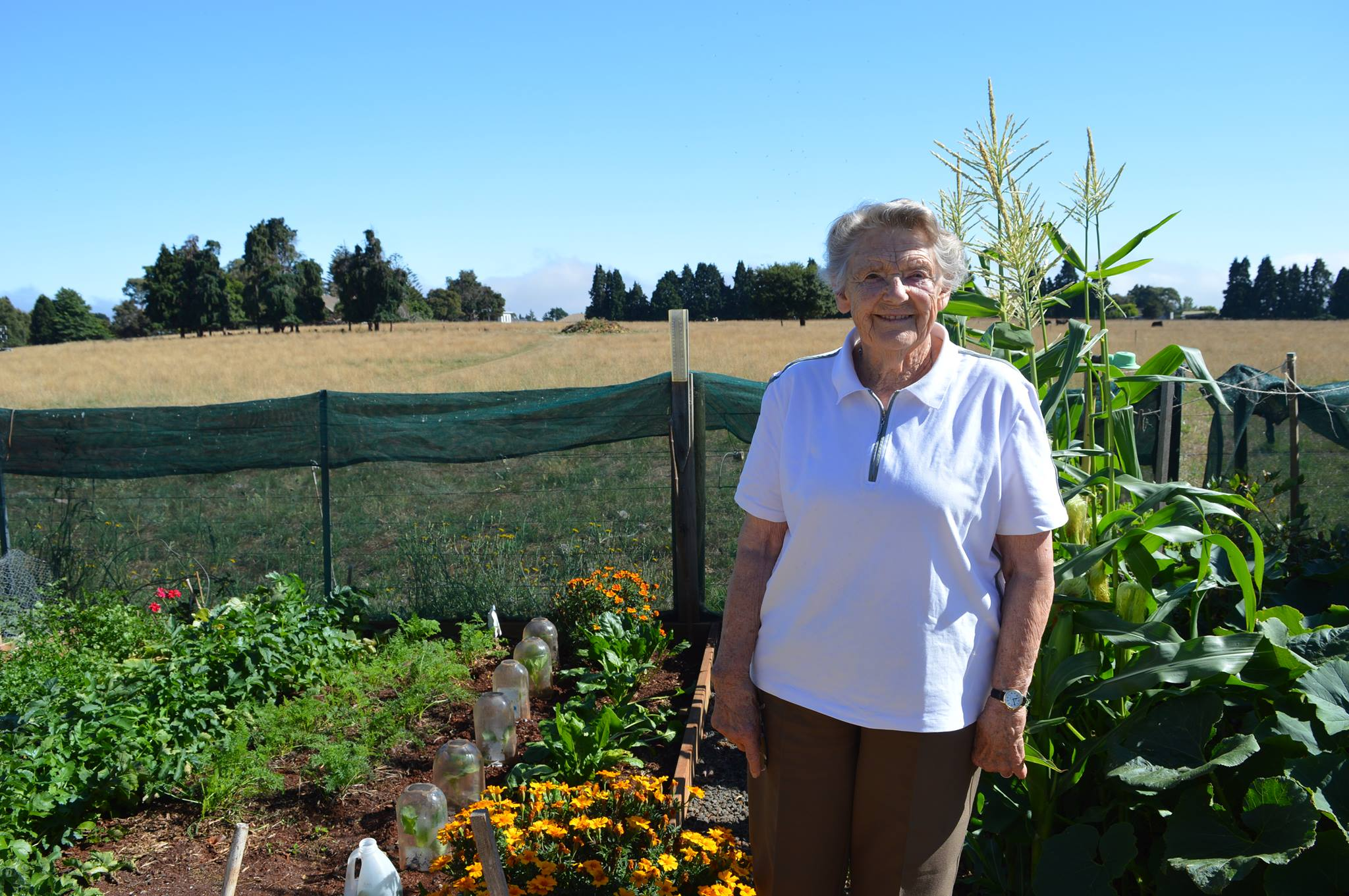 Just days before her 90th birthday, Dawn Kershaw stands in her vegetable garden.