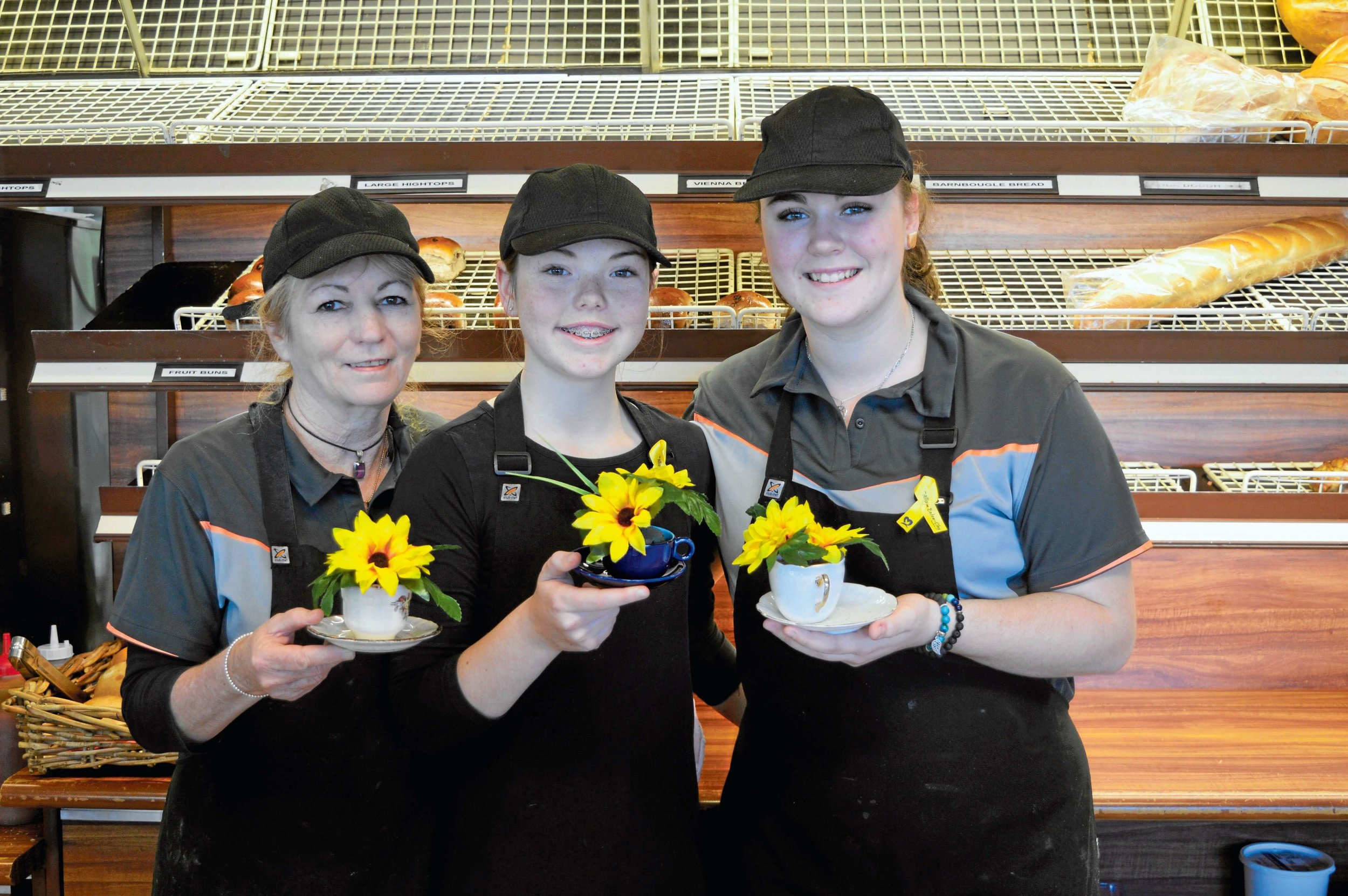 • Cottage Bakery staff Lorraine Carroll, Paige Chorley and Jemaya Hilder spreading kindness to customers.