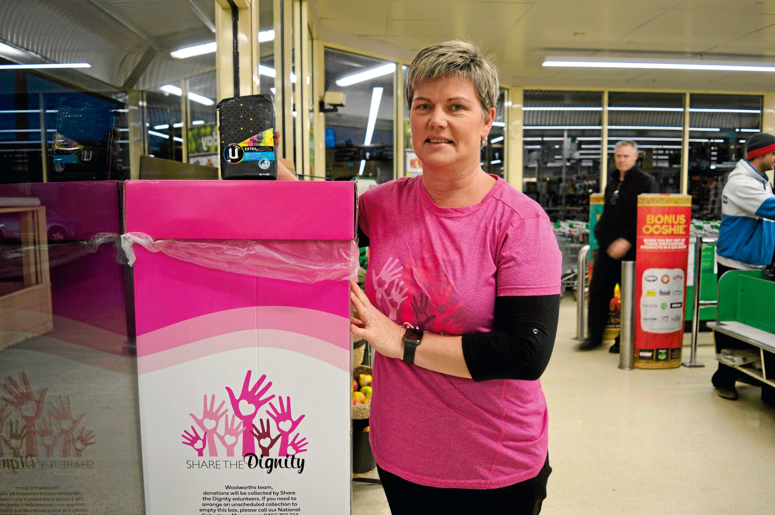 • Local Share the Dignity volunteer Mandy Walters at the collection box at Scottsdale Woolworths.