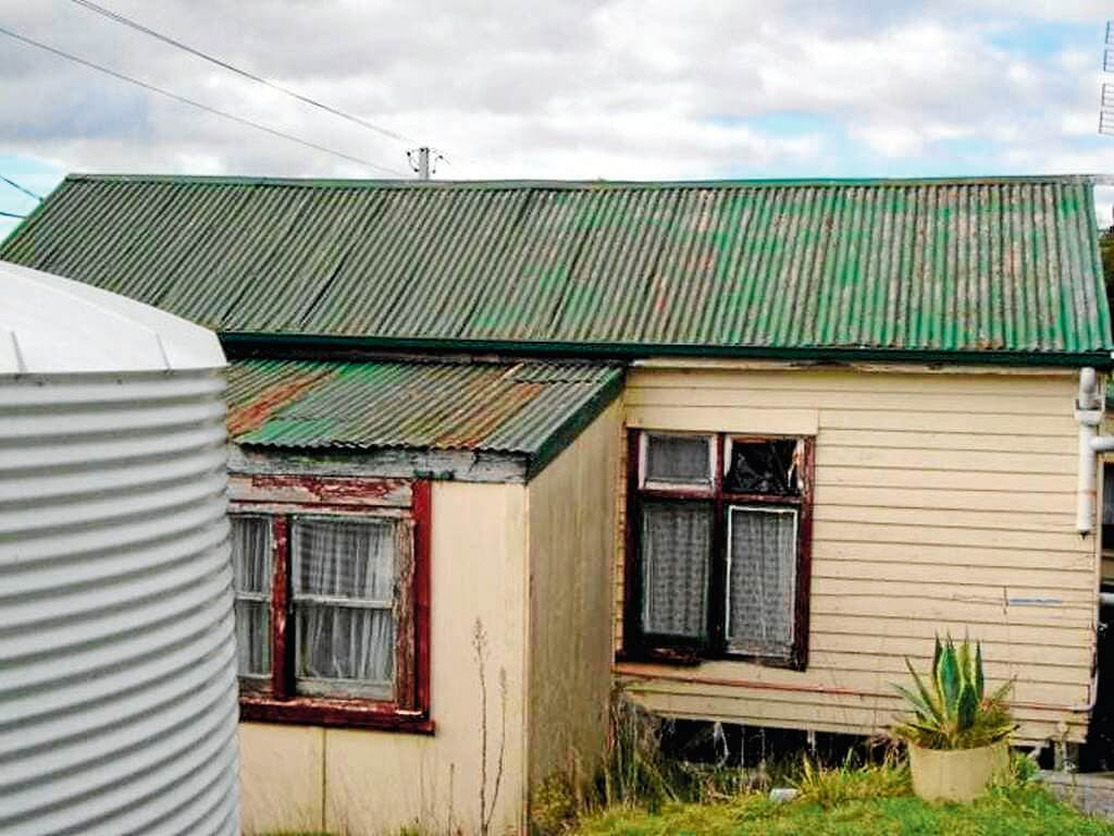 • A Pioneer resident lead painted roof attached to a water tank. Image supplied by Tim Slade.
