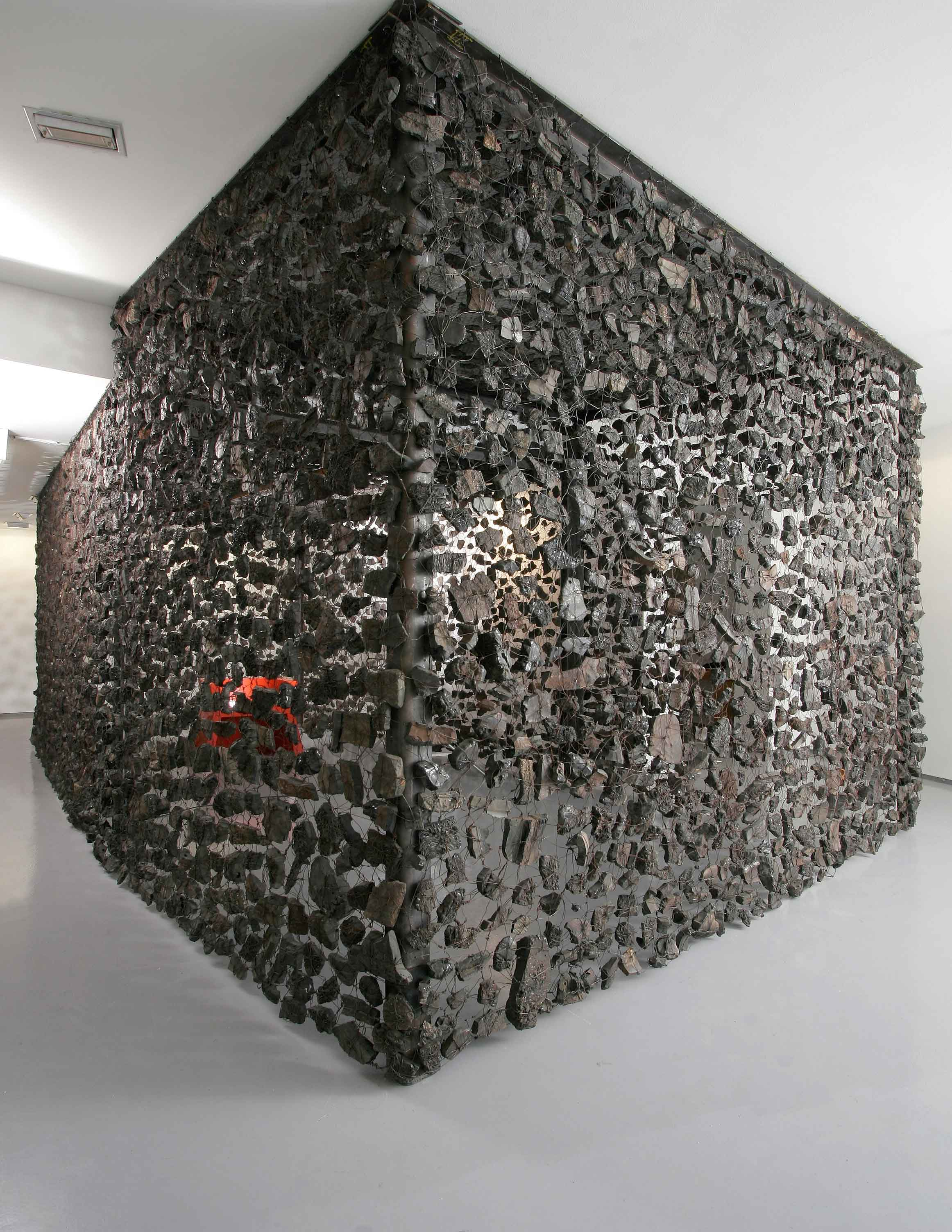 11.-Always-watch-what-the-hands-do,2007,-280-x-600-x-320-cm,-metal-structure,wire,mine-debris,-seat-painted-steel.jpg