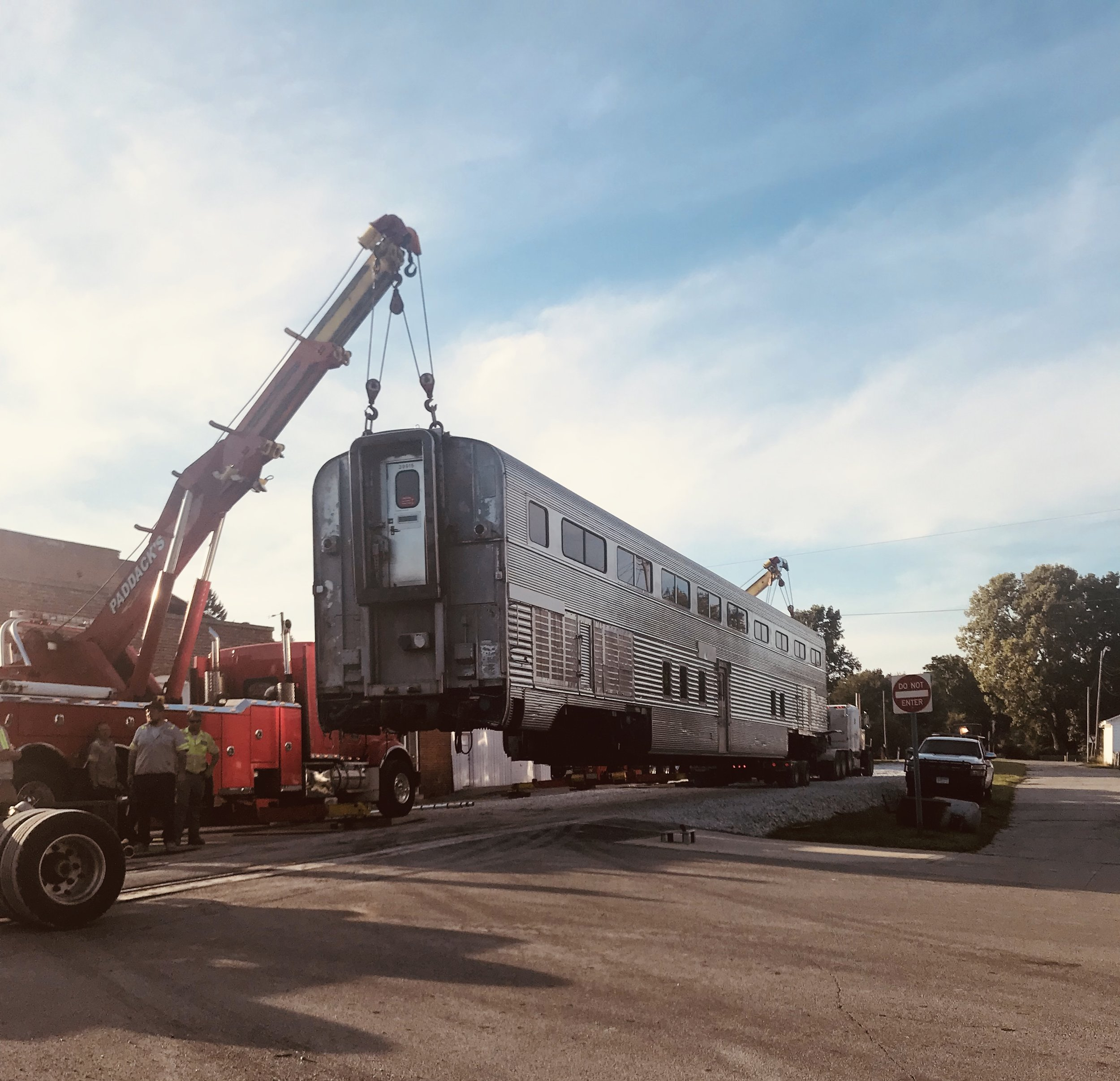 The first Santa Fe car is unloaded onto Arcadia's Main Street.