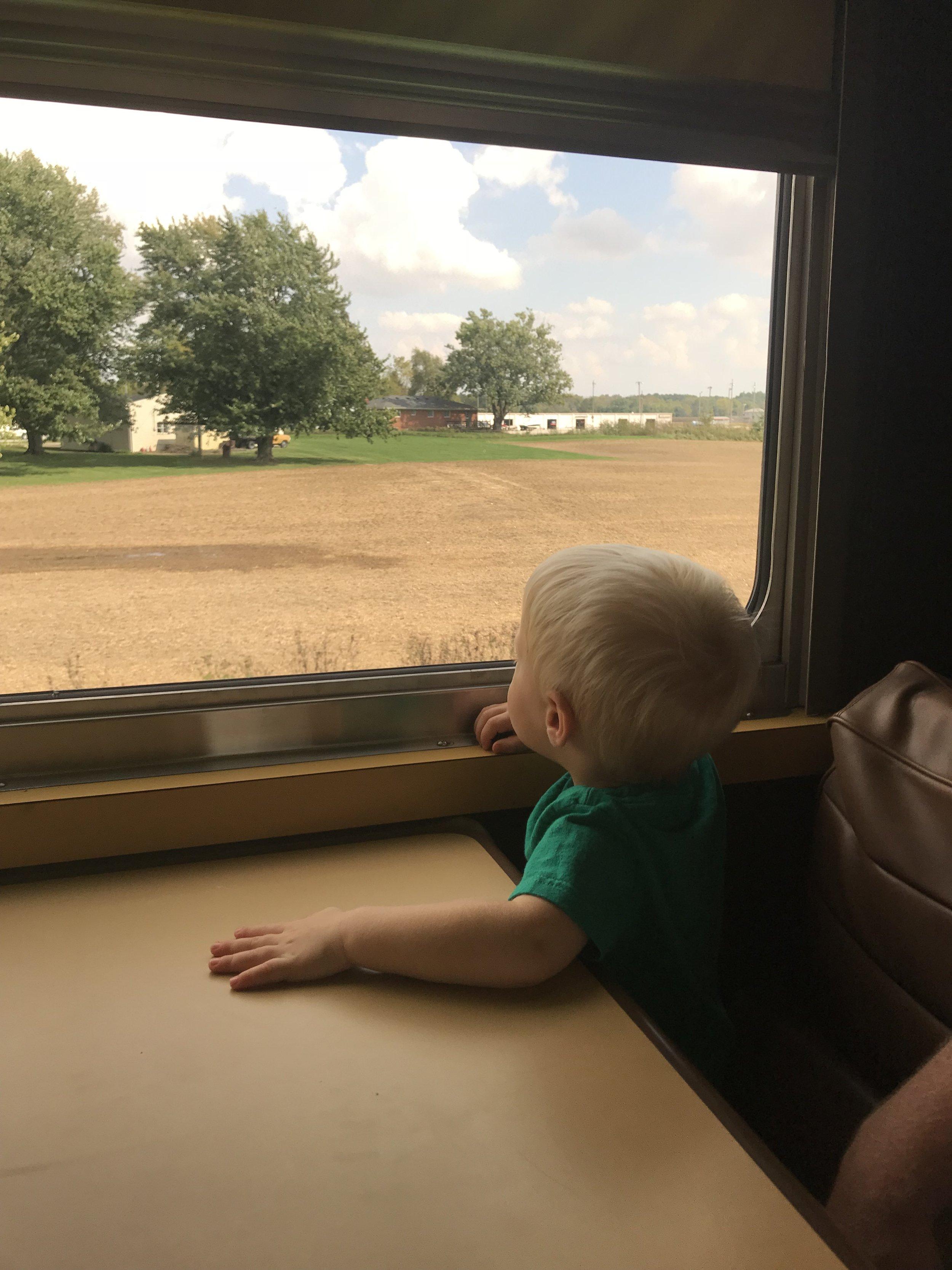 Kid looking out window .jpg