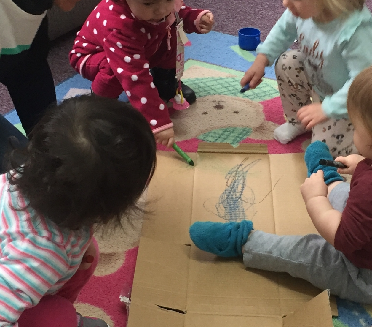 Toddlers drawing a picture.