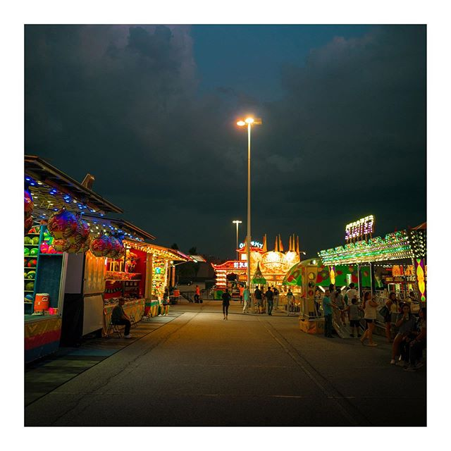 07-31-2019. Parking lot carnival. - I've been making it a habit to keep my camera with me at all times. Last night I saw this carnival and stopped to make a few photos. Should I go back and do an episode of photography behind the scenes with this location? 📷- #leicaqp