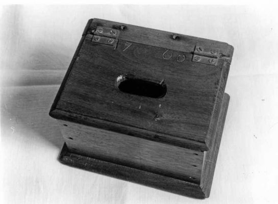 This offering box was used in Deep Run's second building with the date 1766 inscribed on the top of the lid and 1872 underneath.  Credit: Jay Ruth