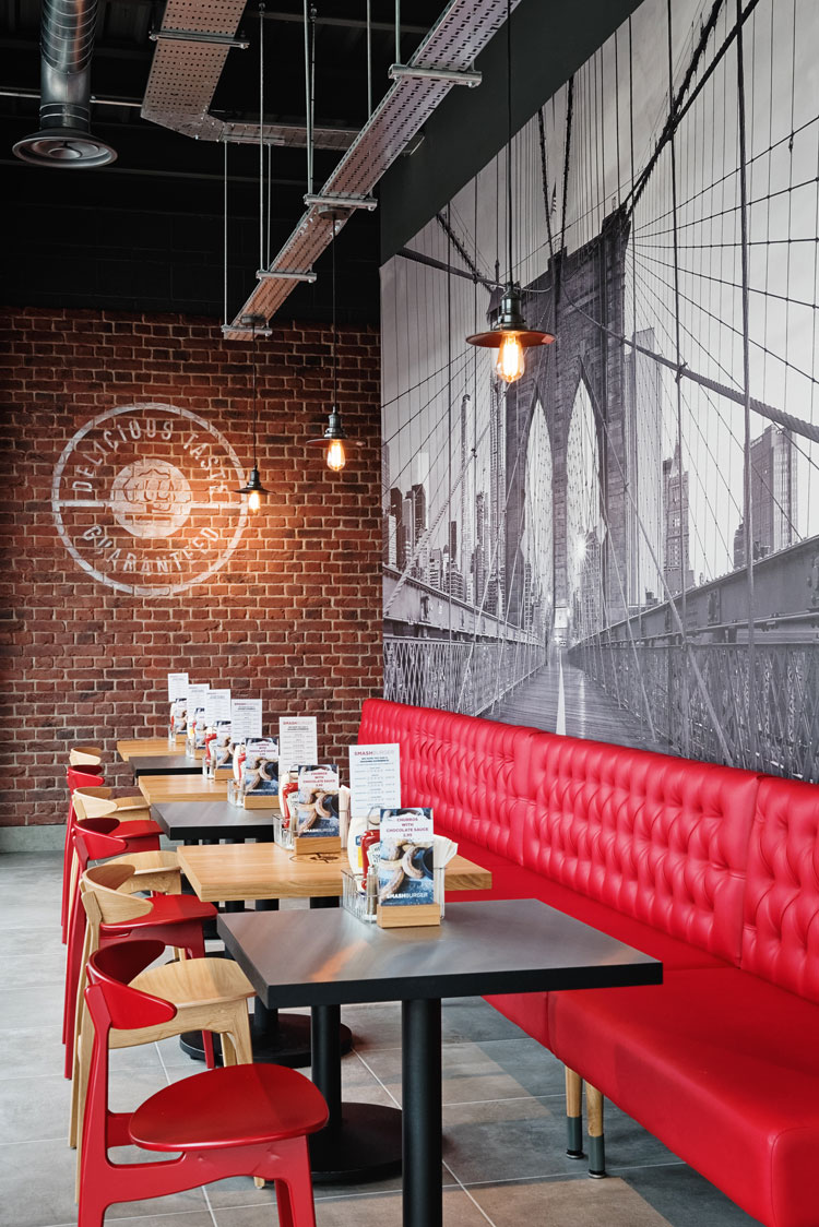 - Industrial palettes blend with authentic diner materials to create a current, urban 'US' experience. An animated brand world uniting place, people and product.