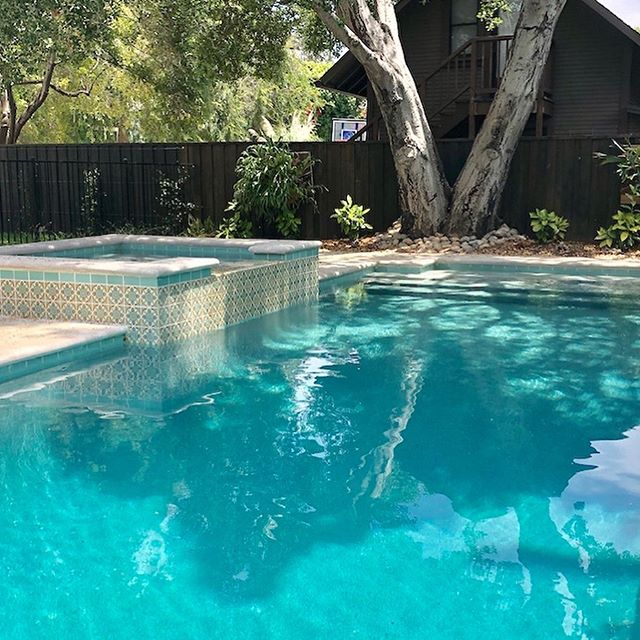 From dark lagoon to restful sanctuary. Swipe to see before #poolremodel #landscapedesign #interiordesignla #pooltiledesign