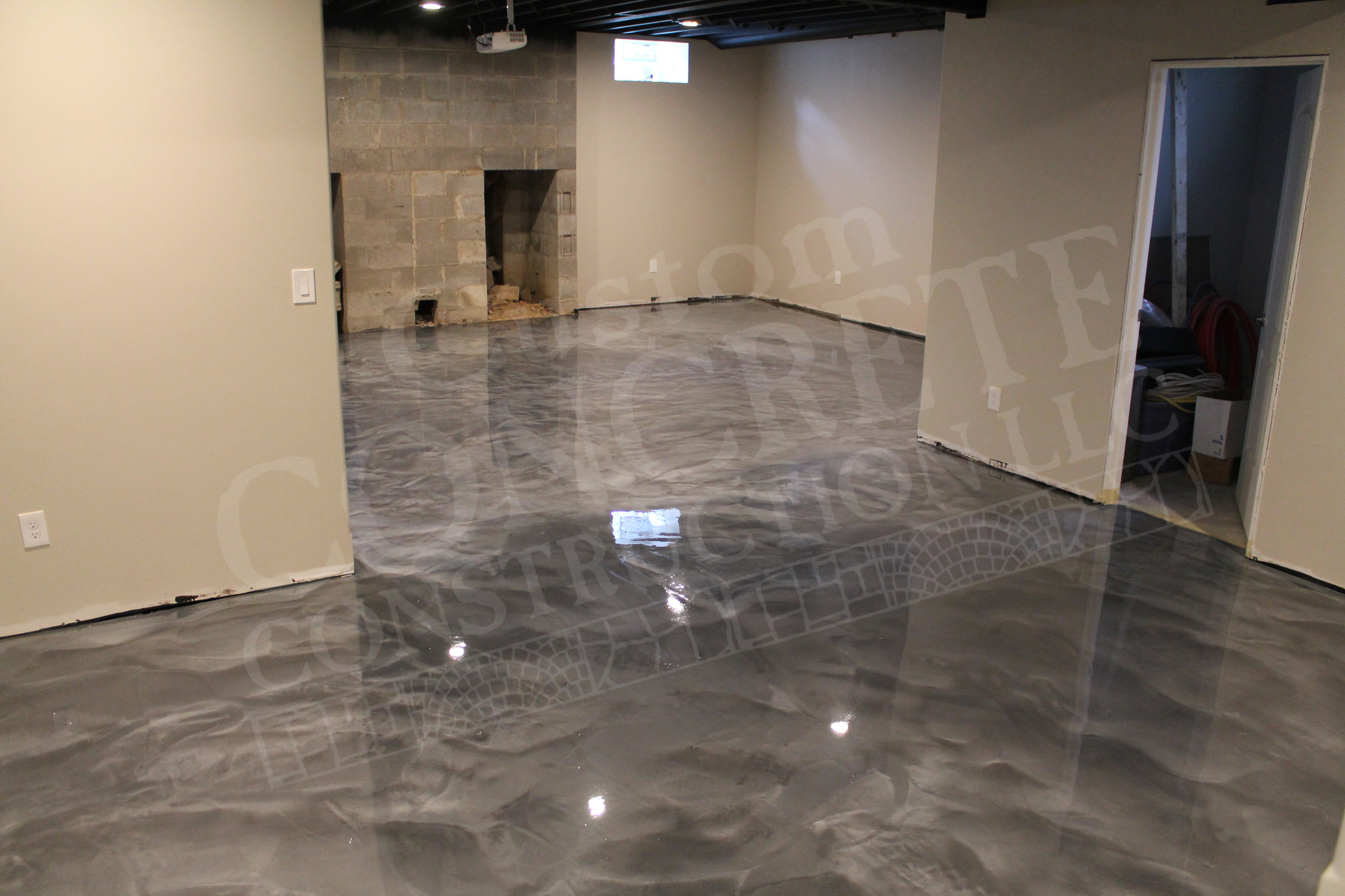 """Liquid Metals"" metallic epoxy overlay on basement floor"