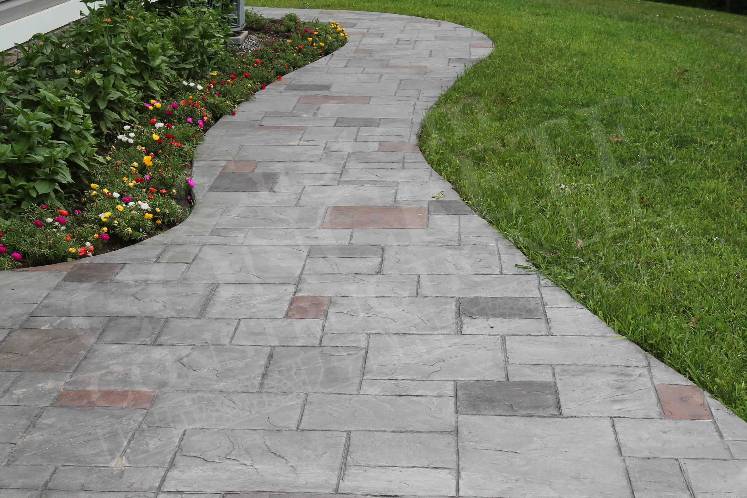 ashlar stamped sidewalk with individual hand-staining work