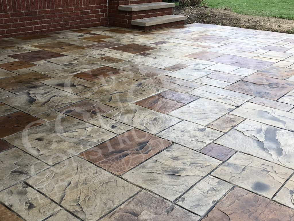 ashlar stamped patio with individual hand-staining work