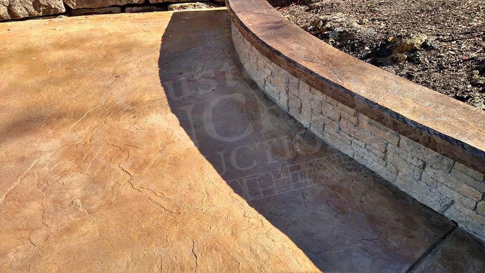 textured stamped patio with pattern stamped seat wall