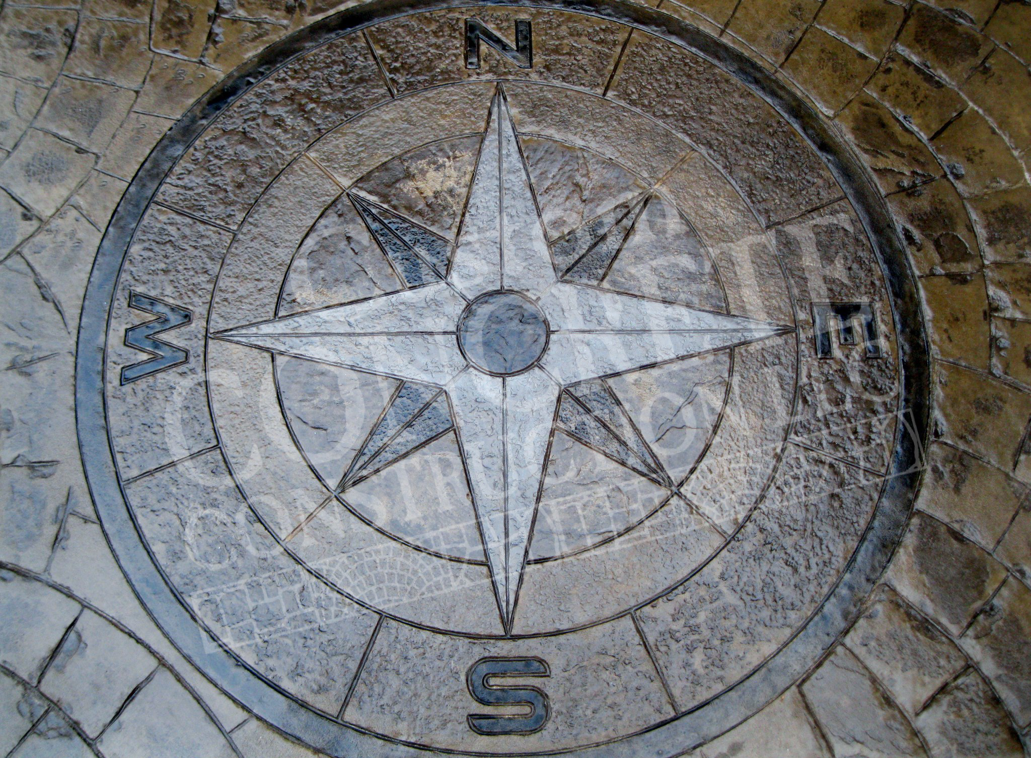 stamped concrete compass medallion with individual hand-stained work