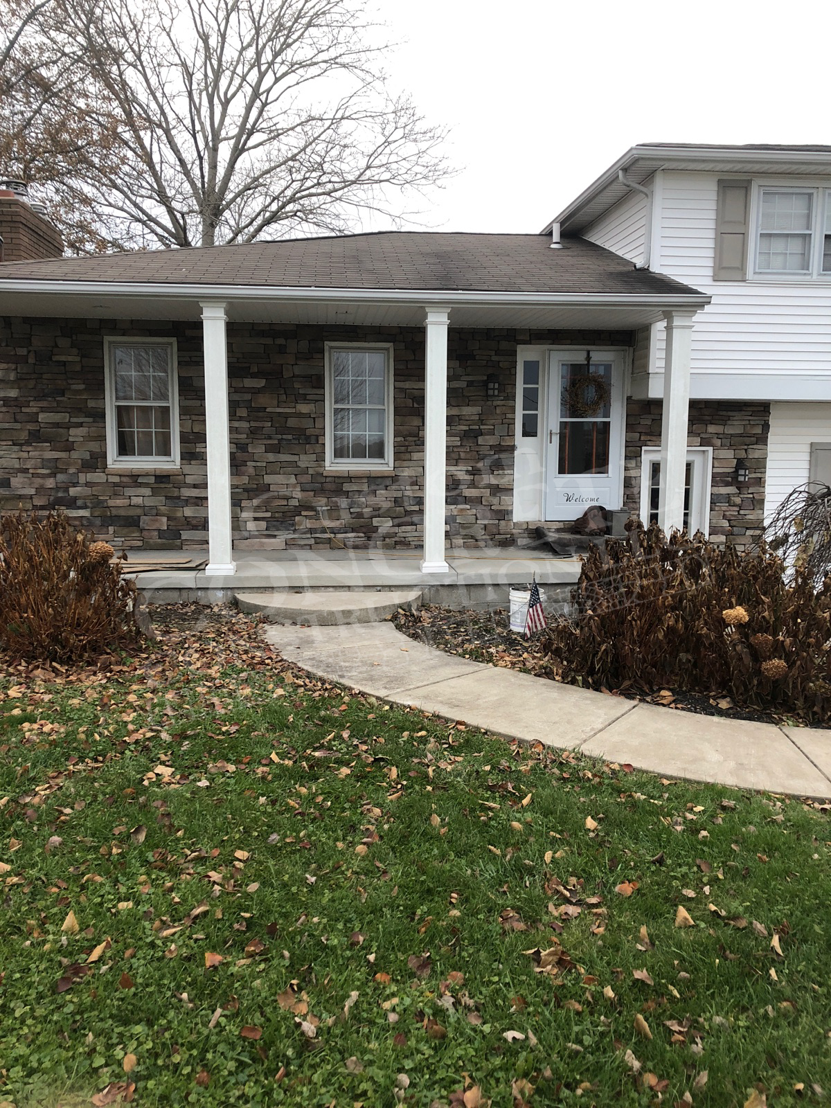 standard brushed porch rebuild with stone veneer