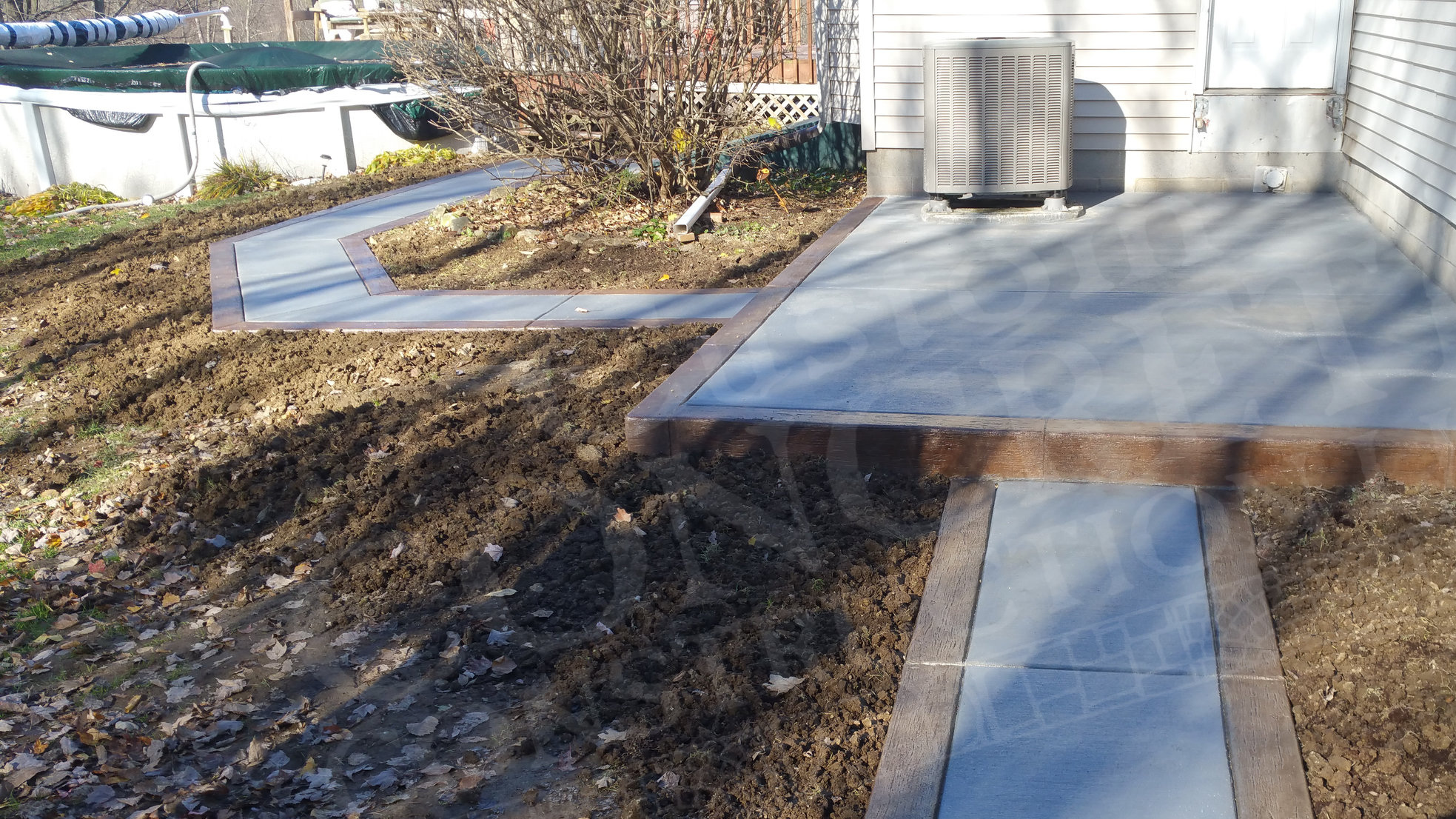 Patio and Sidewalk with Stamped Border completed at an East Palestine home