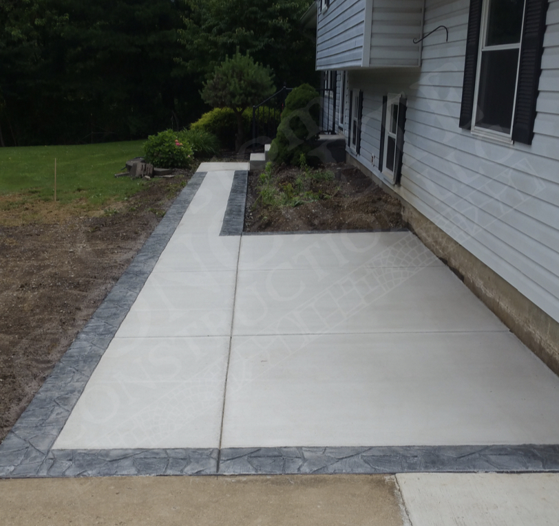 Patio, Sidewalk and Porch Rebuild with Stamped Border completed at an East Palestine home