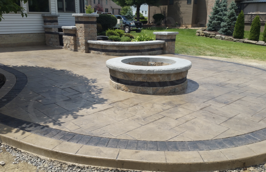 Stamped Patio with Veneer Fire Pit and Outdoor Kitchen completed at a Poland home