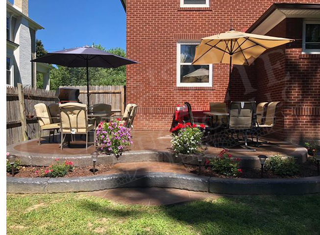 Stamped Patio with landscape planter wall completed at a Salem home